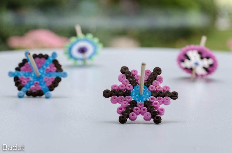 Homemade spinning tops of Hama beads
